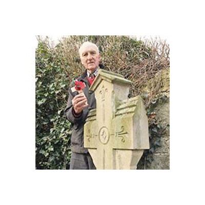 Photo of verger of Whittington Parish Church, Philip Morris, at the gravestone of Trooper Sergeant Major George Smith, 2014.